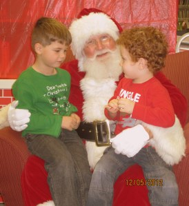 Photo of two small boys with Santa