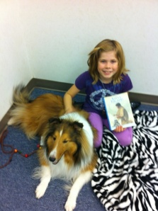 Image of a young girl reading to a dog