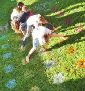 Image of children playing Twister on a lawn
