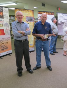 John Foster (left) and Larry Boucher attend the unveiling of the new exhibit about the Civil War history of Cass County, Missouri