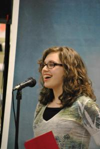 Poetic Voices 2013 contestant recites her poem at the competition.