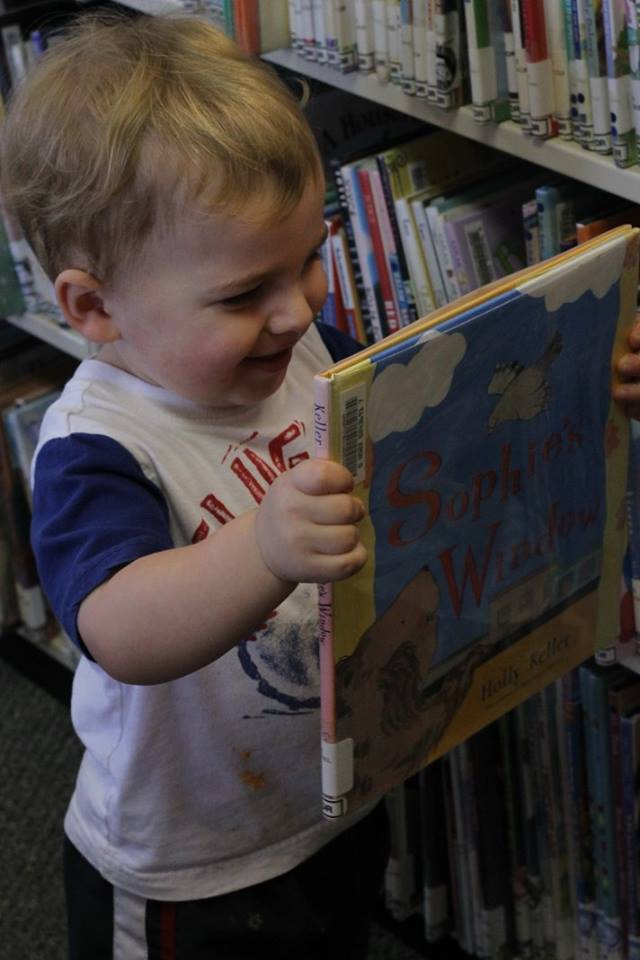 A patron locates a good book at the Harrisonville library. #molibraries