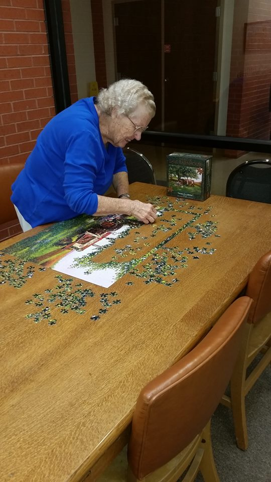 Working a puzzle at the library. #molibraries