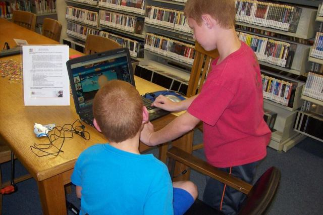 Patrons at Garden City access the wireless internet on a laptop. #molibraries